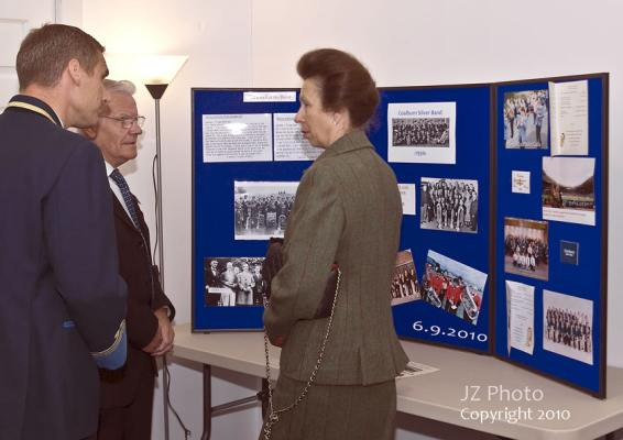 Alan Court, Peter McLeish and Princess Anne discuss the history of the Silver Band